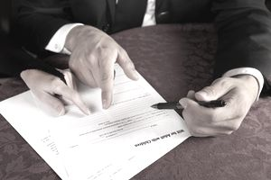 Closeup of hands reviewing a will form