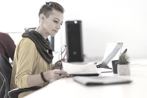 Businesswoman wearing yellow shirt working in the office