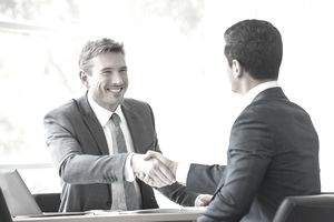 businessmen shaking hands in a meeting