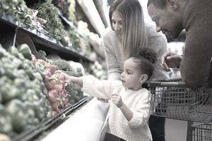 A family shops for groceries