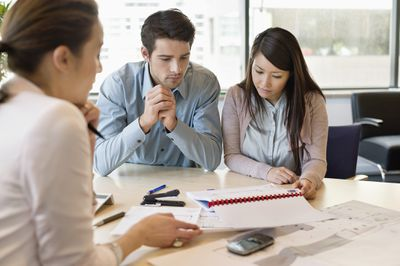 Realtor explaining escrow to young buyers