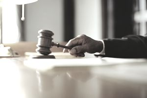 Man striking a gavel