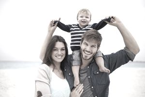 A happy mother and father with young child