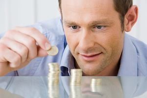a man stacking coins