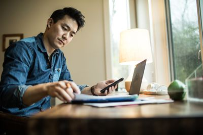 Man works on taxes at home