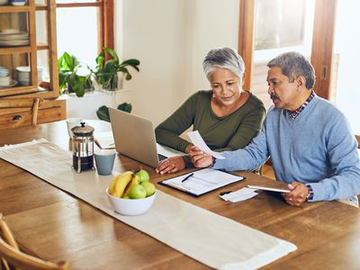 Shot of a mature couple managing their paperwork together at home