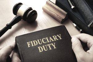 Hands holding Fiduciary duty in an court