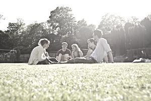 Students have outdoor discussion during a summer class