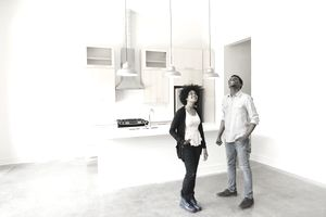 Young couple in empty kitchen of new house