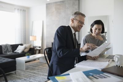 Financial advisor explaining a Keogh retirement plan with client in the client's home.