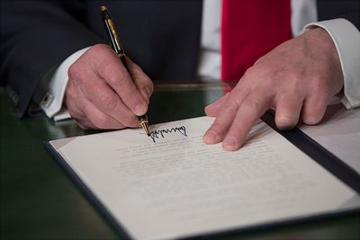 President Donald Trump formally signs his cabinet nominations into law, in the PresidentÕs Room of the Senate, at the Capitol in Washington, January 20, 2017.