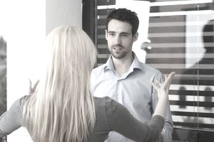 Blonde Coach woman with a man debating, coaching about work