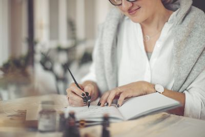 Young businesswoman is writing in a personal organizer