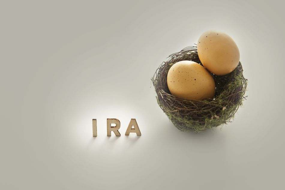 Golden eggs in a nest next to the word 'IRA'
