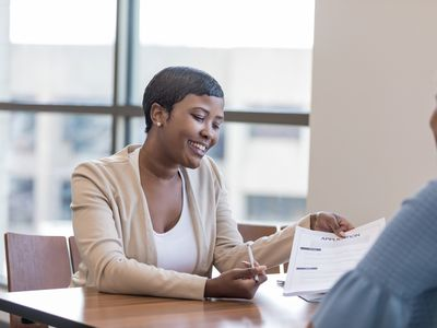 Personal banker explains account application to client
