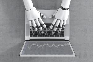 robot hands typing on a laptop keyboard representing day trading futures.