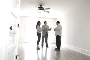 Couple discussing mortgage loans with realtor
