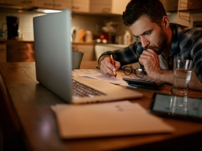 Man reviewing finances at home