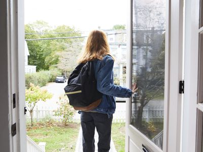 A young woman leaving her home
