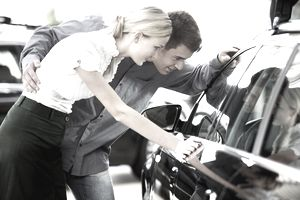 young couple looking to buy new car