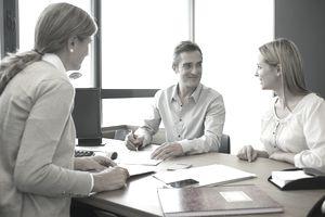 Couple talking with financial advisor