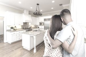 young couple admiring kitchen in new home