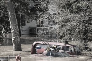 Parked car immersed in flood waters