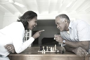 Man and woman smiling over chess game