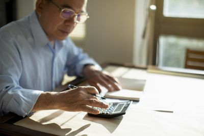 A man calculates his after-tax 401(k) contributions