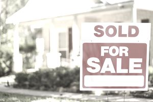 short sale home with sold sign in the front yard