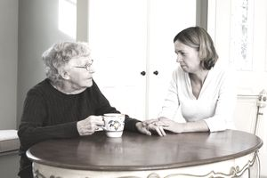Daughter talking about estate planning with Elderly mother