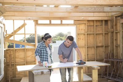 Couple working together on a new home