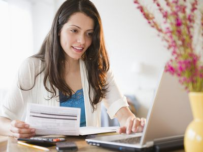 Woman reviewing taxes on a computer