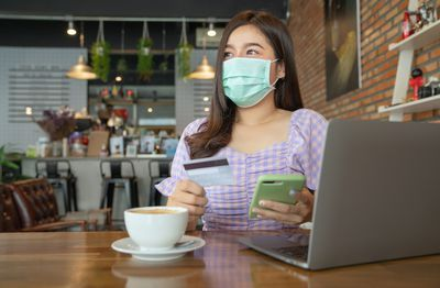 Young asian businesswoman wearing protective mask