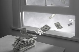 CASH BLOWING OUT OF OPEN WINDOW