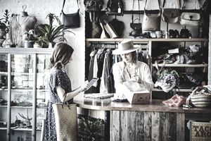 Woman shopping at a small business boutique clothing store.