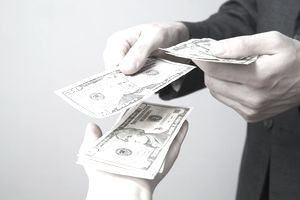 close-up of money in peoples' hands