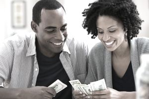 Man and woman counting cash
