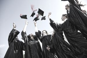 Graduating class tossing their caps in the air.