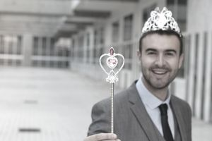 businessman wearing tiara and magic wand