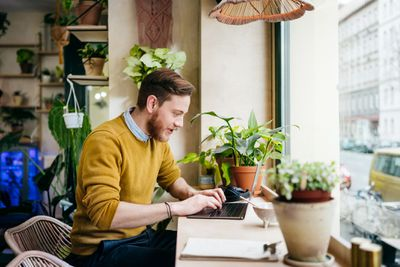 A man working at a laptop at home.