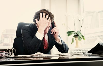 Frustrated Investor on Telephone