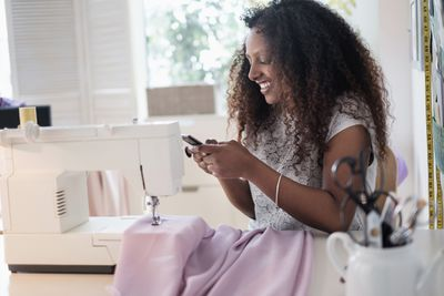 Black business owner at home on phone