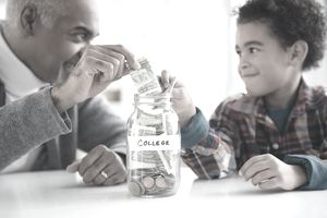 "A grandparent and grandson add cash to a jar labeled ""college"""