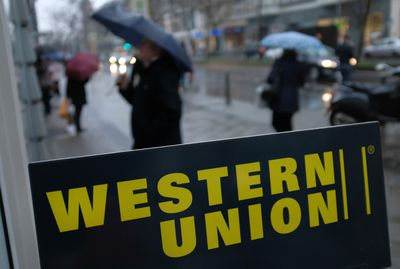 A sign advertises the money transfer service Western Union