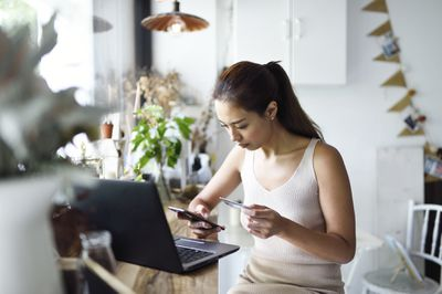 A woman shops online with a credit card.
