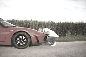 Man hugging his car that he bought with a peer-to-peer loan