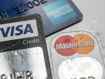 A close-up of three well-used credit cards