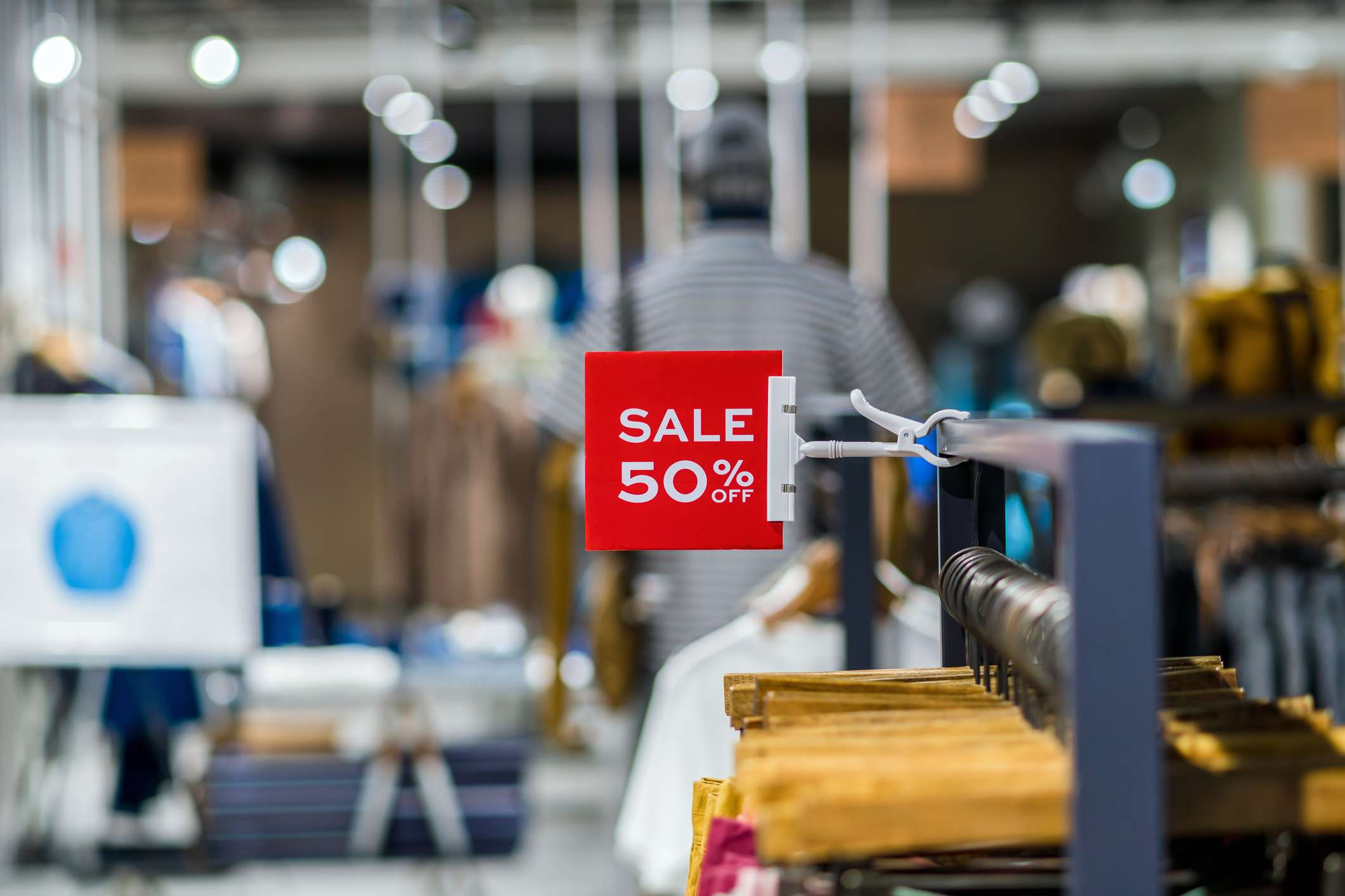 50% off sale sign in a clothing store