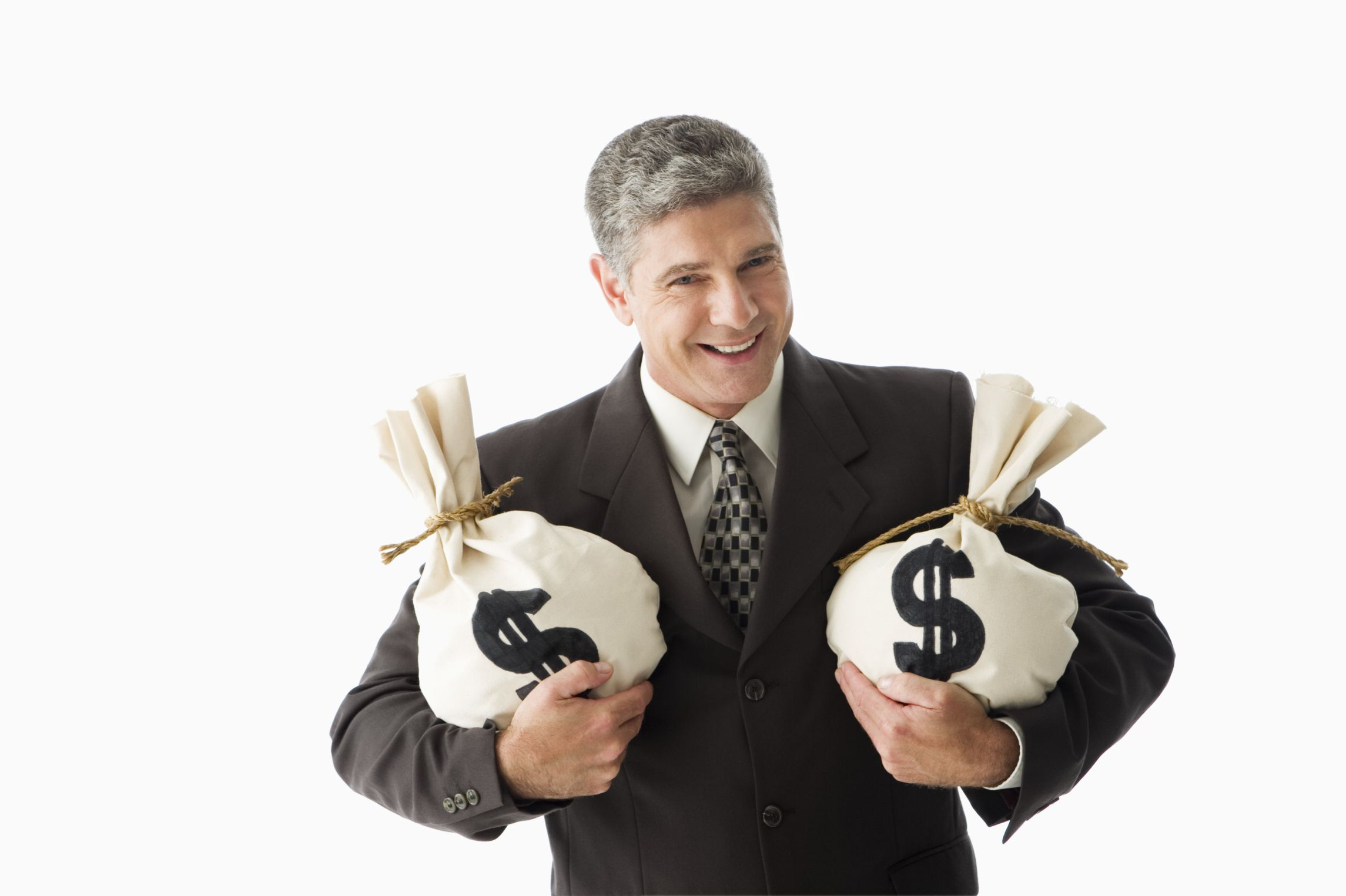 Smiling businessman holding money bags